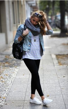 Take your summer layers, like your go-to denim jacket, into fall with a thick knit scarf. Pair the look with leggings, a striped tee and your favorite sneakers for a casual, cool look.