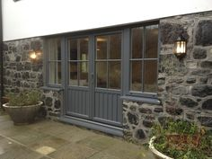French Doors with side windows installed into te traditional stone in the Cornwall Cottage. The Effective Pictures We Offer You About french doors front of house A quality picture can tell you many th Aluminium French Doors, Aluminium Windows And Doors, Upvc Windows, External French Doors, External Doors, Up House, House Front, Cottage Door, Barn Renovation