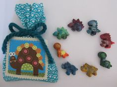$6 -- 8 glittery rainbow dino crayons in a blue goodie bag    heard from a reliable source that kids love these crayons :)