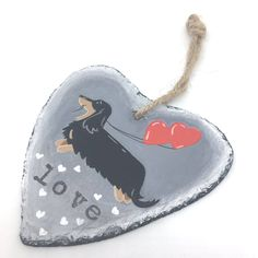 A personal favourite from my Etsy shop https://www.etsy.com/uk/listing/480444002/dachshund-slate-hanger-gift-of-love-hand