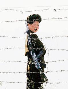 Guard: A female North Korean soldier