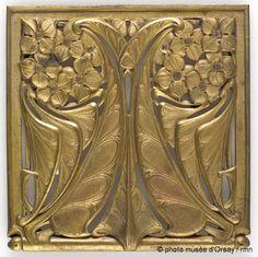 Follot - Plaque a decor de petites fleurs et feuillages lanceoles (Plate decorated with small flowers and lanceolate leaves) c1909. Gilded bronze