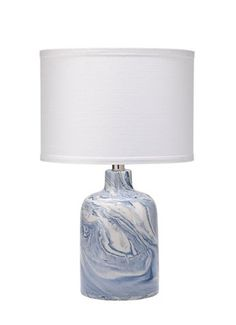 With its blue-and-white marble glaze and rolled linen shade, this ceramic table lamp refreshes any surface with clean, contemporary appeal. Blue Table Lamp, Ceramic Table Lamps, Living Room Accessories, White Marble, Blue And White, Bulb, Shades, Ceramics, Contemporary