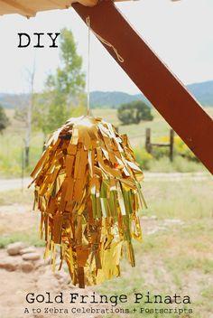Glammed up pinata. DIY Gold Fringe Pinata 1