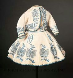 1867 child's dress. I am suspicious that it might be for a very young boy, since it is a bit plain in decoration with no bows or lace.