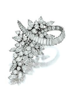 DIAMOND BROOCH, CARTIER, CIRCA 1960 Designed as a floral cluster enhanced by a scrolling ribbon, set with marquise-shaped, brilliant-cut and baguette diamonds, mounted in platinum, signed Cartier.
