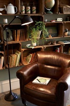 Love the crate bookcases. Nothing like a broken-in leather chair