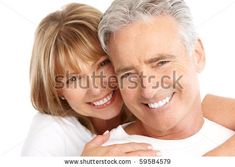 Older Couples Poses for Photography | Happy seniors couple in love. Healthy teeth. Isolated over white ...