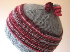 This is a fun way to use up your bits and pieces! The hat at top fits a baby, and was knit in the round with scraps of Rowan Pure Wool 4-ply and bits of Frog Tree Alpaca. The little pink and red hat in the second photo was made in several worsted weight yarns. I have made these hats out of many types of yarn (even bulky) with great results. And you never know exactly how it will look!