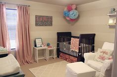 Pompoms and subtle neutral stripes for a baby's room. Soft colors that grow with baby. Love this idea!