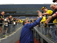 David Brandon receives support for his many accomplishments as Michigan athletic director.
