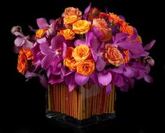 Love the color combination of the orchids and roses
