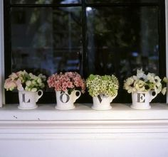 pretty and a lovely idea for using mugs.  I love when I see things and know exactly where I would put them.