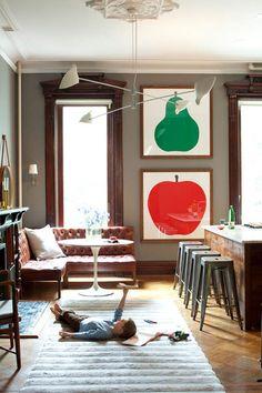 wood trim~artwork~plush carpet~leather sofa~industrial stools~lovethis
