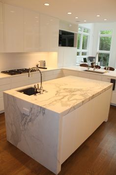 modern white kitchen. cabinets by Green Living Designs