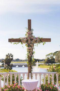 Wooden cross wedding ceremony backdrop. Was so in love!