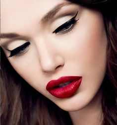 Deep red lip, winged eyeliner.  Is there anything more classic than this?