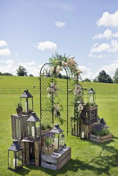 wooden crates wedding ideas metal arch decorated with flowers surrounded by boxes with lanterns mark tattersall photography arch entrance 36 Rustic Wooden Crates Wedding Ideas Wedding Reception Entrance, Wedding Arch Rustic, Outdoor Wedding Decorations, Metal Wedding Arch, Lantern Wedding, Wedding Arches, Backdrop Wedding, Ceremony Backdrop, Ceremony Decorations