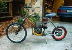 Very homemade-looking. Flathead mower engine, perhaps Briggs.