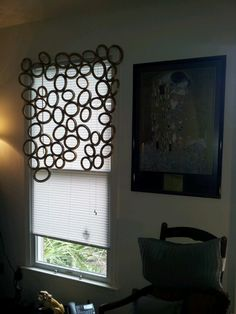 An artsy DIY window valance made by me out of wooden picture frames !