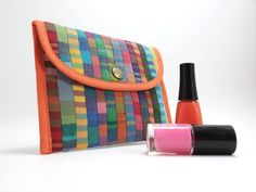 Modern quilt small pouch / Purse organizer, sanitary pad holder / Multicoloured stripes and orange lining.