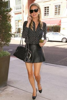 Nicky Hilton wearing Chanel Chain Around Quilted Bowling Bag, Christian Louboutin Bianca Back-Zip Pump in Black.