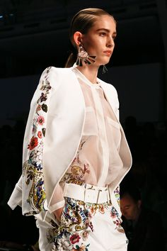Collarless blouse and floral details at Etro Spring 2013
