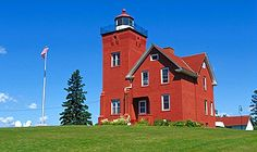 Two Harbors Light: Currently in a Bed and Breakfast run by the Lake County Historical Society. It came into service in 1892, with it's red brick tower lit with a Fourth Order Fresnel lens. At that time, Two Harbors was the most important shipping point for the region's iron ore. The current optic is a DCB 224mm plastic lens.  It is still an active aid to navigation, maintained by the USCG.  lighthousegetaway.com/lights/twoharbors.html