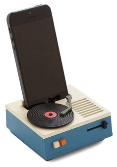 While you're at home or working away, keep your phone propped up in this turntable-inspired EP phone stand ($20), which is crafted from wood and has a slot for a charging cord of any size.
