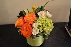 Floral arrangement (orange roses)