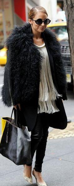 Who made Nicole Richie's white fringe top, black leather pants, black sunglasses, and handbag that she wore in New York? Shirt – Stella McCartney  Purse – Fendi  Pants – J Brand  Sunglasses – House of Harlow