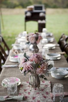 Silver vases, burlap, and florals.