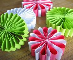 paper flower ornaments. uses letter sized paper, one each! (and a staple and double sided tape)