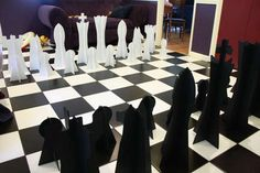 Giant Chess, laser cut from coroplast. Collapsible for really easy storage, this chess set works great on 1' squares in a kitchen or on a patio.