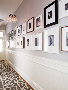 hallway gallery -- mixing black, white and wood toned frames (looks great!)