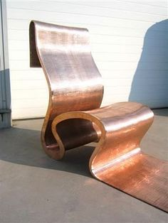 Chair by Ron Arad. Metal is a popular material used in informalist design as it is raw and industrial. This particular design's shape should be noted as its shape is very loose and free-flowing, not upright and measured.