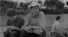 THE LAST PICTURE SHOW - Timothy Bottoms & Ben Johnson discuss life while fishing in a stock tank - Based on the novel by Larry McMurtry - Directed by Peter Bogdonavich - Columbia Pictures - Movie Still. Picture Movie, The Last Picture Show, Timothy Bottoms, Harry Carey, Orange Quotes, Don Johnson, Film Grab, Romance Movies, Columbia Pictures