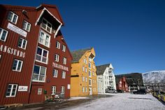 City dock in Tromso, Norway is enlivened by colorful buildings lining the harborfront