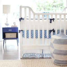 A #blue accent table sets off these great #cobalt crib sheets. #nursery #cribsheets