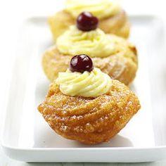 Zeppole o bignè di San Giuseppe: delicious puff pastry with pastry cream and cherries.