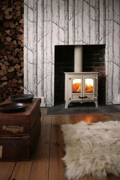 "New Photos Fireplace Hearth flush Concepts Beautiful woodburner fire brought to life with Cole & Sons ""Woods"" feature wall Fireplace Hearth, Fireplace Design, Brick Fireplaces, Fireplace Ideas, Cole And Son Wallpaper, Wood Wallpaper, Log Burner, Reno, House Design"