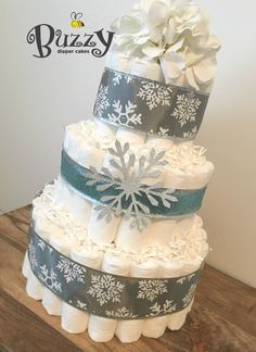 Winter Wonderland Diaper Cake, Winter Baby Shower, Snowflake diaper cakes, Blue and Gray Snowflake Diaper Cake, Shower Centerpiece by BuzzyDiaperCakes on Etsy https://www.etsy.com/listing/261875931/winter-wonderland-diaper-cake-winter