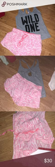 VS pajama set💕 VS pajama set. Size xs but will also comfortably fit a small. Gray tank that is semi cropped. Keyhole back. Shorts are tiger print pink with slits on the sides and a draw string. 💎note that I placed fabric underneath the shirt and shorts to show slurs and keyhole. This is not actually a part of the product💎 Victoria's Secret Intimates & Sleepwear Pajamas