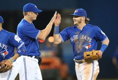 Josh Donaldson Photos - Josh Donaldson #20 of the Toronto Blue Jays celebrates their victory with Gavin Floyd #39 during MLB game action against the Oakland Athletics on April 23, 2016 at Rogers Centre in Toronto, Ontario, Canada. - Oakland Athletics v Toronto Blue Jays