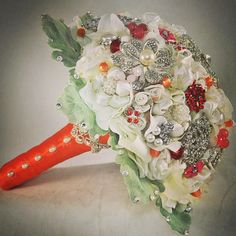 """""""Couture Flowers"""" Bridal Bouquet dressed in orange"""
