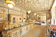Pfunds Dairy, Dresden,Germany: The most beautiful dairy shop in the world« is confirmed by an entry in the Guinness Book of Records. The interior decoration of the dairy shop founded by the Pfund brothers in 1880 comprises fantastically embellished tile paintings in the style of neo-Renaissance. The hand-painted motifs on the walls, floor and shop counter were produced in the art department of the Dresden stoneware factory Villeroy and Boch.