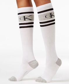 A sporty style for the style savvy, these logo-splashed socks from Calvin Klein offer premium comfort from the knee down. | Combed cotton/nylon/spandex | Machine washable | Imported | Contrast stripe
