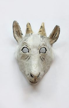 'Light papier-mache mask hand painted with gauche and lacquered, fastened with a rubber strap.' - made by Yevgeniya Kilupe (born in 1938), Latvia
