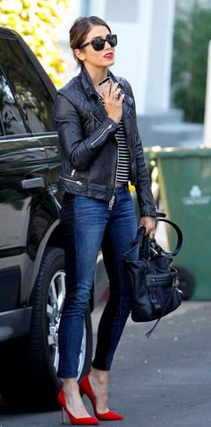 Outfit: Nikki Reed wears a moto jacket, stripe tee, skinny jeans, and red pointed-toe pumps, via @sarahsarna.