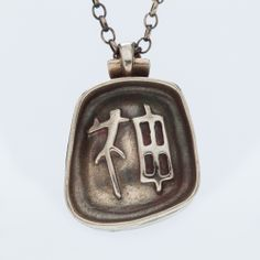 Have a look of the texture of this jewish jewelry. Japanese character is stamped on the one side of this pendent.